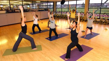 Rachel Brysacz, Yoga Instructor (front left) leads the aerobathon group in a strecthing exercise.